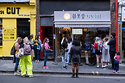 With many people and families staying in the UK for their Summer break during the school holidays, a large number of domestic tourists, who may normally have been travelling abroad, have decended on the capital to see the sights, as seen here queueing outside a bubble tea shop in Chinatown on 10th August 2021 in London, United Kingdom. Following the Coronavirus / Covid-19 health scare of the last two years, and with some travel restrictions still in place, more people have chosen a staycation which is a holiday spent in ones home country rather than abroad, or one spent at home and involving day trips to local attractions.