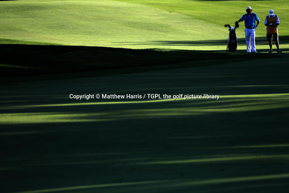 Jason DUFNER (USA) and caddie wait to play 2nd shot to 18th during fourth round US PGA Championship 2013,Oak Hill CC,