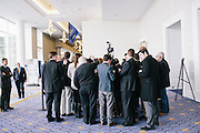Members of the media surround Al Cardenas, chair of the American Conservative Union, during day two of the Conservative Political Action Conference (CPAC) at the Gaylord National Resort & Convention Center in National Harbor, Md.