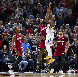 January 7, 2018 - Miami, FL, USA - Miami Heat forward James Johnson (16) tries to block Utah Jazz guard Donovan Mitchell's (45) buzzer shot in the last seconds of the fourth quarter on Sunday, Jan. 7, 2018 at the AmericanAirlines Arena in Miami, Fla. The Miami Heat defeated the Utah Jazz, 103-102. (Credit Image: © Matias J. Ocner/TNS via ZUMA Wire)