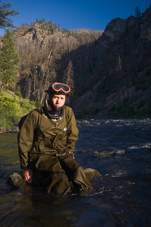 US Geological Survey (USGS) research landscape ecologist Christian Torgersen takes a break from diving the river to count fish and map the river bed during a field expedition to survey Big Creek, a tributary of the Salmon River, in the Frank Church - River of No Return Wilderness, Idaho.