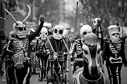 17 Feb 2015. New Orleans, Louisiana.<br /> Mardi Gras Day. Walking with Skeletons. <br /> The Skeleton Krewe meets before dawn beside a cemetery in Uptown New Orleans. They then walk several miles Along Saint Charles Avenue to the French Quarter to celebrate Mardi Gras Day.<br /> Photo; Charlie Varley/varleypix.com