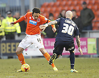 Blackpool's Nathan Delfouneso in action with Millwall's Richard Chaplow<br /> <br /> Photographer Mick Walker/CameraSport<br /> <br /> Football - The Football League Sky Bet Championship - Blackpool v Millwall - Saturday 10th January 2015 - Bloomfield Road - Blackpool <br /> <br /> © CameraSport - 43 Linden Ave. Countesthorpe. Leicester. England. LE8 5PG - Tel: +44 (0) 116 277 4147 - admin@camerasport.com - www.camerasport.com