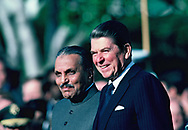 Preasiednet Reagan and Mohammad Zia, Pakistan at an arrival ceremony for Mohammad Zia of Pakistan on December 6, 1982<br />Photo by Dennis Brack