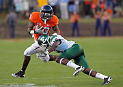 Oct 23, 2010; Charlottesville, VA, USA; Virginia Cavaliers running back Perry Jones (33) is tackled by Eastern Michigan Eagles cornerback Arrington Hicks (19) during the 1st half of the game at Scott Stadium.  Mandatory Credit: Andrew Shurtleff
