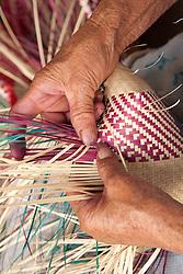North America, Mexico, Oaxaca Province, Oaxaca, hands weaving straw baskets in market