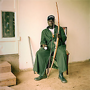 Michael Ezangu is a security guard at the Kulika Lutisi training centre farm. He uses a torch and a bow and arrow to protect the farm from intruders.