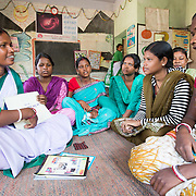 CAPTION: Sahiya Anupma Soren takes a monthly session with the 15-19-year olds. The discussion covers delaying the age of marriage, antenatal care, where the ARSH clinic is and what it does, the methods of family planning that the facility can help with, and what their respective pros and cons are. The Government requires these sessions to be conducted monthly. Sahiyas are given an incentive of ₹ 75 per session they lead. The girls are asked to come on a regular basis, as the knowledge imparted builds over time. LOCATION: Pawra Anganwadi Centre (AWC), Ghatshila (block), Purbi Singhbhum (district), Jharkhand (state), India. INDIVIDUAL(S) PHOTOGRAPHED: From left to right: Anupma Soren, Pritilata Giope, Sarshati Hansda, Maya Namata, Kajal Namata, Anjana Hembrom and Sunita Murmu.
