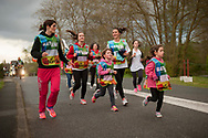 """People run on the 20th Korrika. Arbona (Basque Country) April 2, 2017. The """"Korrika"""" is a relay course, with a wooden baton that passes from hand to hand without interruption, organised every two years in a bid to promote the basque language. The Korrika runs over 11 days and 10 nights, crossing many Basque villages and cities, totalling some 2300 kilometres. Some people consider it an honour to carry the baton with the symbol of the Basques, """"buying"""" kilometres to support Basque language teaching. (Gari Garaialde / Bostok Photo)"""