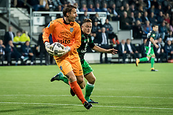 (L-R) goalkeeper Bram Castro of Heracles Almelo, Jens Toornstra of Feyenoord during the Dutch Eredivisie match between Heracles Almelo and Feyenoord Rotterdam at Polman stadium on September 09, 2017 in Almelo, The Netherlands