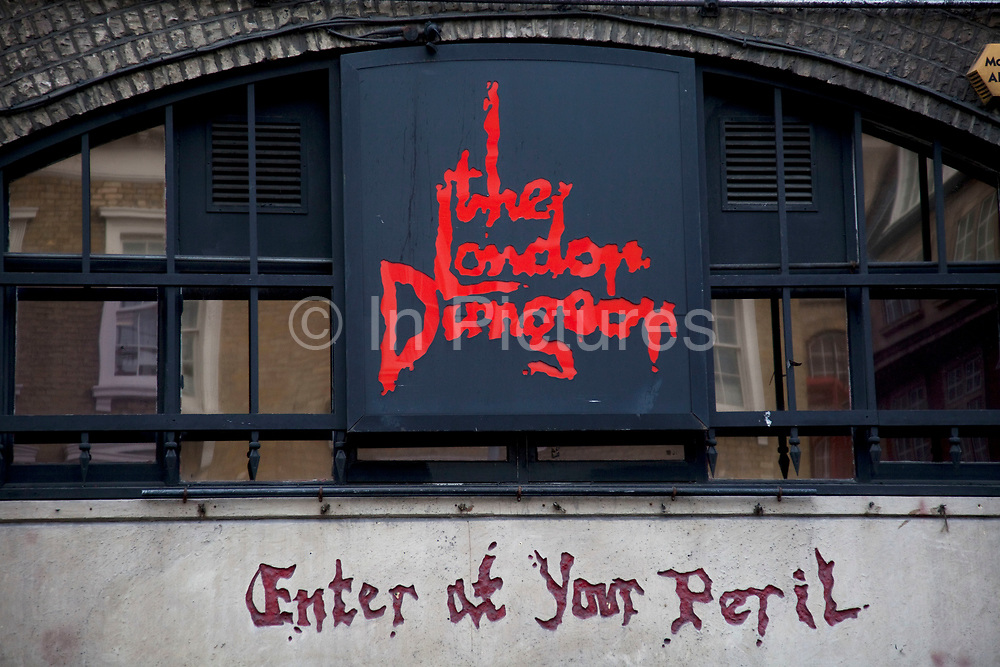 """Tourists queue up outside the London Dungeons at London Bridge. The London Dungeon is a popular London tourist attraction,[1] which recreates various gory and macabre historical events in a grimly comedic 'gallows humour' style, attempting to make them appealing to younger audiences. It uses a mixture of live actors, special effects and rides.Opening in 1974, it was initially designed as more a museum of """"horrible history"""", but the Dungeon has evolved to become an actor-led, interactive experience."""