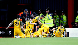 Brighton & Hove Albion players celebrate after Solly March  (obscured) scores his side's first goal of the game