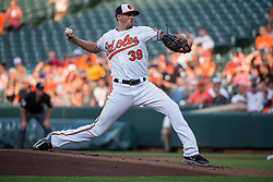 July 19, 2017 - Baltimore, MD, USA - Baltimore Orioles pitcher Kevin Gausman works against the Texas Rangers in the first inning at Oriole Park at Camden Yards in Baltimore on Wednesday, July 19, 2017. The Orioles won, 10-2. (Credit Image: © Michael Ares/TNS via ZUMA Wire)