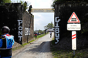France, April 13th 2014: View of a train on the level crossing from Pont Gibus. The train closed the level crossing as the race approached Pont Gibus, Wallers, during the 2014 Paris Roubaix cycle race.