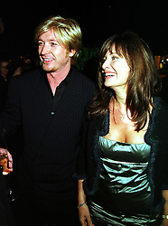 Top hairdresser NICKY CLARKE and LESLEY CLARKE, at a party in London on 21st September 1999.MWO 50