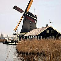 Europe, The Netherlands, Zaanse Schans. Windmill in winter.