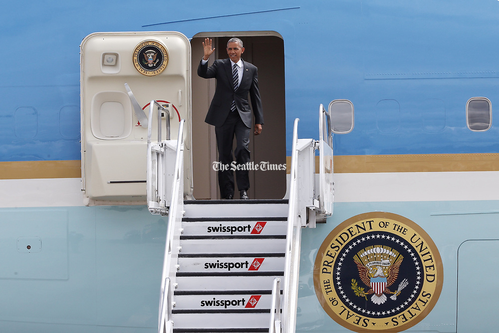 President Barack Obama waves to people waiting for his arrival at Sea-Tac on Friday, June 24, 2016. (Johnny Andrews / The Seattle Times)