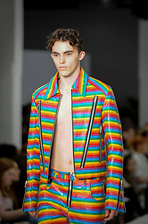 © Licensed to London News Pictures. 06/06/2018. LONDON, UK.  A model presents a look by Takato Wako from Nottingham Trent University at the Best of Graduate Fashion Week 2018 show at the Old Truman Brewery in East London. The event presents the graduation show of up and coming fashion designers from UK and international universities.  Photo credit: Stephen Chung/LNP