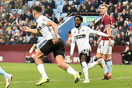 Swansea City striker Courtney Baker-Richardson (46) wheels away in celebration after scoring the first goal, while Swansea City midfielder Nathan Dyer (12) looks delighted during the The FA Cup 3rd round match between Aston Villa and Swansea City at Villa Park, Birmingham, England on 5 January 2019.