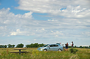 Visitors with spotting scopes at Buffalo Camp on the Great Plains of Montana at American Prairie Reserve. South of Malta in Phillips County, Montana.