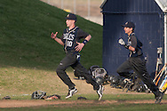 Goshen, New York - John S. Burke Catholic players run around the bases after a varsity baseball game on April 21, 2014.