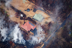 2018 05 24 - Pahoa, Hawaii, USA:  Huge ground cracks form directly under a home in the Leilani Estates subdivision, indicating shallow magma movement, and a potential eruption site.<br />Photo: ZUMA/Bruce Omori/Paradise Helicopters