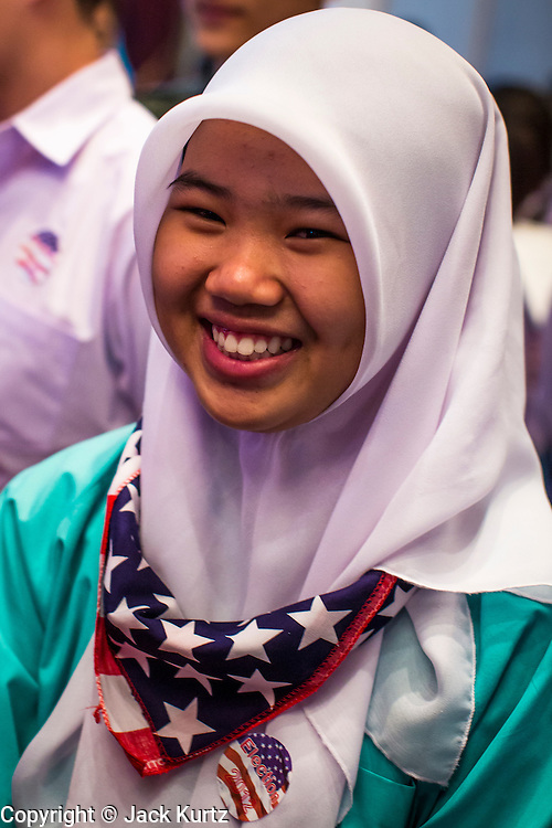 07 NOVEMBER 2012 - BANGKOK, THAILAND:   A Muslim Thai high school student wore a red, white and blue bandana to the US Embassy's election watch party in Bangkok. US President Barack Obama won a second term Tuesday when he defeated Republican Mitt Romney. Preliminary tallies gave the President more than 300 electoral votes, well over the 270 needed to win. The election in the United States was closely watched in Thailand, which historically has very close ties with the United States. The American Embassy in Bangkok sponsored an election watching event which drew thousands to a downtown Bangkok hotel. American Democrats in Bangkok had their own election watch party at a restaurant in Bangkok.     PHOTO BY JACK KURTZ