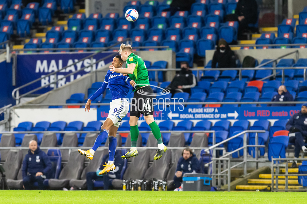Cardiff City's Robert Glatzel (9) competes for a high ball with Birmingham City's Marc Roberts (4) during the EFL Sky Bet Championship match between Cardiff City and Birmingham City at the Cardiff City Stadium, Cardiff, Wales on 16 December 2020.