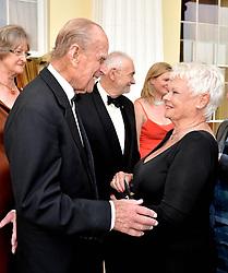 The Duke of Edinburgh (left) with Dame Judi Dench, during a Gala Evening marking the 60th anniversary of The Duke of Edinburgh's Award, at Stoke Park, Stoke Poges, Buckinghamshire.