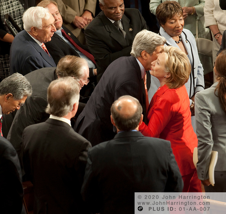 Secretary of State Hillary Clinton greets Sen. John Kerry (D-MA) prior to President Obama delivering an address to a joint session of Congress to promote his health care reform agenda, Wednesday, September 9, 2009 at the US Capitol.
