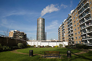 Accumulator Tower at Churchill Gardens on 11th February 2016 in London, United Kingdom. The 136 feet high glass accumulator tower at Churchill Gardens formed part of the UKs first district heating system built in 1947-50. Churchill Gardens is a large housing estate in the Pimlico area of Westminster, London. The estate was developed between 1946 and 1962. Designed by the architects Powell and Moya, it replaced Victorian terraced houses extensively damaged during the Blitz.