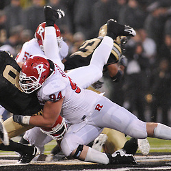 Oct 23, 2009; West Point, N.Y., USA; Rutgers defensive tackle Scott Vallone (94) sacks Army quarterback Trent Steelman (8) during Rutgers' 27 - 10 victory over Army at Michie Stadium.