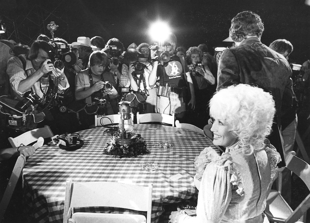 """©1982 Actors Burt Reynolds and Dolly Parton at the premiere of the movie """"Best Little Whorehouse in Texas""""  ©1982"""
