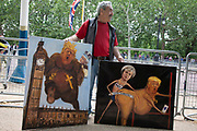 On the first day of the state visit by US President Donald Trump political artist Kaya Mar comes to protest with his latest paintings on 3rd June 2019 in London, United Kingdom.