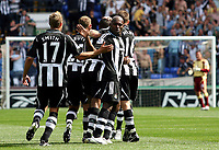 Photo: Paul Thomas. <br />Bolton Wanderers v Newcastle United. Barclays Premiership. 11/08/2007. <br /><br />Newcastle along with Alan Smith (17) and captain Geremi (R) celebrate their first goal.