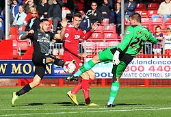 Peterborough United's Jon Taylor challenges Crawley's Jamie Ashdown and Sonny Bradley - Photo mandatory by-line: Joe Dent/JMP - Mobile: 07966 386802 - 11/10/2014 - SPORT - Football - Crawley - Checkatrade.com Stadium - Crawley Town v Peterborough United - Sky Bet League One