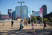 Runners taking part in a 10 kilometre running event, with WestField shopping centre on the horizon, at the Queen Elizabeth Olympic Park on the 21st September 2019 in London in the United Kingdom. RunThrough is a London based running community who organise regular running events, training sessions as well as coaching.