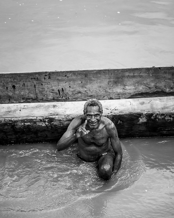 A man from the village of Likan bathes beside a dugout canoe in the village of Yar, located on the Keram River in Papua New Guinea.<br /><br />(June 22, 2019)
