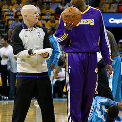 April 22, 2011; New Orleans, LA, USA; Los Angeles Lakers shooting guard Kobe Bryant (24) talks with referee Joe Crawford (17) before game three of the first round of the 2011 NBA playoffs against the New Orleans Hornets at the New Orleans Arena.    Mandatory Credit: Derick E. Hingle
