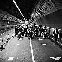 As part of the culture year they opened the Birkenhead tunnel for.pedestrians. Thankfully they decided to stop traffic so it was safe..It was really interesting though. They had signs up so you knew when.you were under the Mersey and where you were in town. Everyone stopped.midway to get a photo of themselves by the sign.  They also stopped by.the old entrance to peek down it.  The weirdest thing though was that.we were stalked by a marching band. The acoustics were great and even.when the band were about half a mile away I could barely hear my.sister talking to me. It was also surprisingly warm in there. Whenever.I drive through I can instantly feel the temperature drop and so I was.expecting to be cold. 5 minutes in and I had to take my coat off..Pretty interesting afternoon all in all, and the band followed us back.across on the ferry too. Our own personal band for the day.