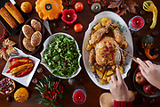 Thanksgiving traditional food on the table decorated with gourds berries chestnuts leaves and candles - Flat lay overhead shot