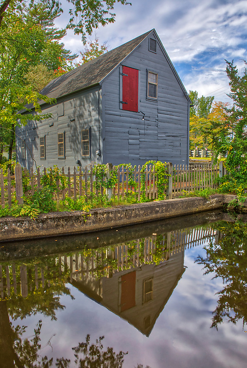The Spaulding Grist Mill framed by early fall colors in Townsend Middlesex County Massachusetts.<br /> <br /> The Spaulding Grist Mill Central Massachusetts photography images are available as museum quality photography prints, canvas prints, acrylic prints, wood prints or metal prints. Fine art prints may be framed and matted to the individual liking and interior design decorating needs.<br /> <br /> Good light and happy photo making!<br /> <br /> My best,<br /> <br /> Juergen