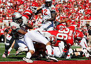 Utah runningback Eddie Wide (36) gets past UNLV defenders for a touchdown in the second quarter of an NCAA college football game at Rice-Eccles Stadium, Saturday, Sept. 11, 2010, in Salt Lake City, Utah.  (AP Photo/Colin E. Braley)