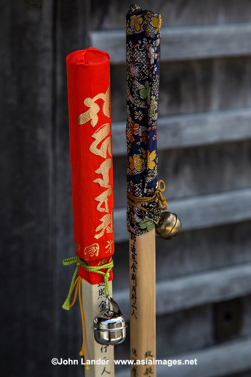 """Henro Walking Sticks or Staffs - Henro is the Japanese word for pilgrim - who are recognizable by their special walking sticks, white clothing and straw sedge hats The Shikoku Pilgrimage is a trail of 88 temples on the island of Shikoku. It is believed all 88 temples were visited by the famous Buddhist monk Kukai, founder of the Shingon school, who was born in Zentsuji Temple in 774. To complete the pilgrimage, it is not necessary to visit the temples in order. The pilgrimage is traditionally completed on foot, but modern pilgrims use cars, taxis, buses, bicycles or motorcycles. The walking course is approximately 1200km long and can take anywhere from 30 to 60 days to complete. """"Henro"""" is the Japanese word for pilgrim - they are recognizable by their white clothing, sedge hats, and walking sticks."""