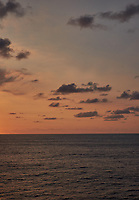 Orange colored sky and clouds over the Pacific Ocean just after sunrise. Image 10 of 10 for a wide-angle panorama taken with a Fuji X-T1 camera and 35 mm f/1.4 lens  (ISO 200, 35 mm, f/16, 1/250 sec). Raw images processed with Capture One Pro and stitched together with AutoPano Giga Pro.