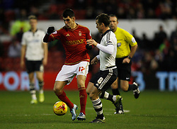Nelson Oliveira of Nottingham Forest (L) and Scott Parker of Fulham in action - Mandatory byline: Jack Phillips / JMP - 07966386802 - 5/12/2015 - FOOTBALL - The City Ground - Nottingham, Nottinghamshire - Nottingham Forest v Fulham - Sky Bet Championship