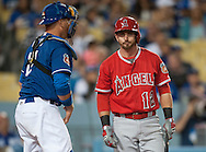The Angels' Johnny Giavotella doesn't look happy after not being able to get a bunt down in front of Dodgers' catcher A.J. Ellis during their Freeway Series game Friday night at Dodger Stadium.<br /> <br /> <br /> ///ADDITIONAL INFO:   <br /> <br /> freeway.0402.kjs  ---  Photo by KEVIN SULLIVAN / Orange County Register  --  4/1/16<br /> <br /> The Los Angeles Angels take on the Los Angeles Dodgers at Dodger Stadium during the Freeway Series Friday.<br /> <br /> <br />  4/1/16