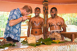 The Duke of Sussex smells a bowl of kava as he views a demonstration of kava making by Joeli Nasqqa (centre) and Eparama Uluiuiti (right) at a dedication of the Colo-i-Suva forest to the Queen's Commonwealth Canopy in Suva, Fiji, on day two of the royal couple's visit to Fiji.