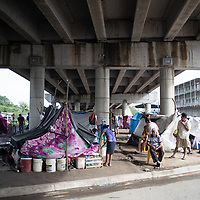 People made homeless by the hurricanes Eta and Iota shelter under the overpass at Chamelecón.<br /> <br /> Hurricanes Eta and Iota hit hard on the north coast of Honduras, leaving some areas flooded for three weeks, destroying people's furniture, belongings, vehicles and houses as well as standing crops.