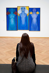 Woman looking at painting  Evolution by Piet Mondriaan at Gemeentemuseum in The Hague, Den Haag,  Netherlands